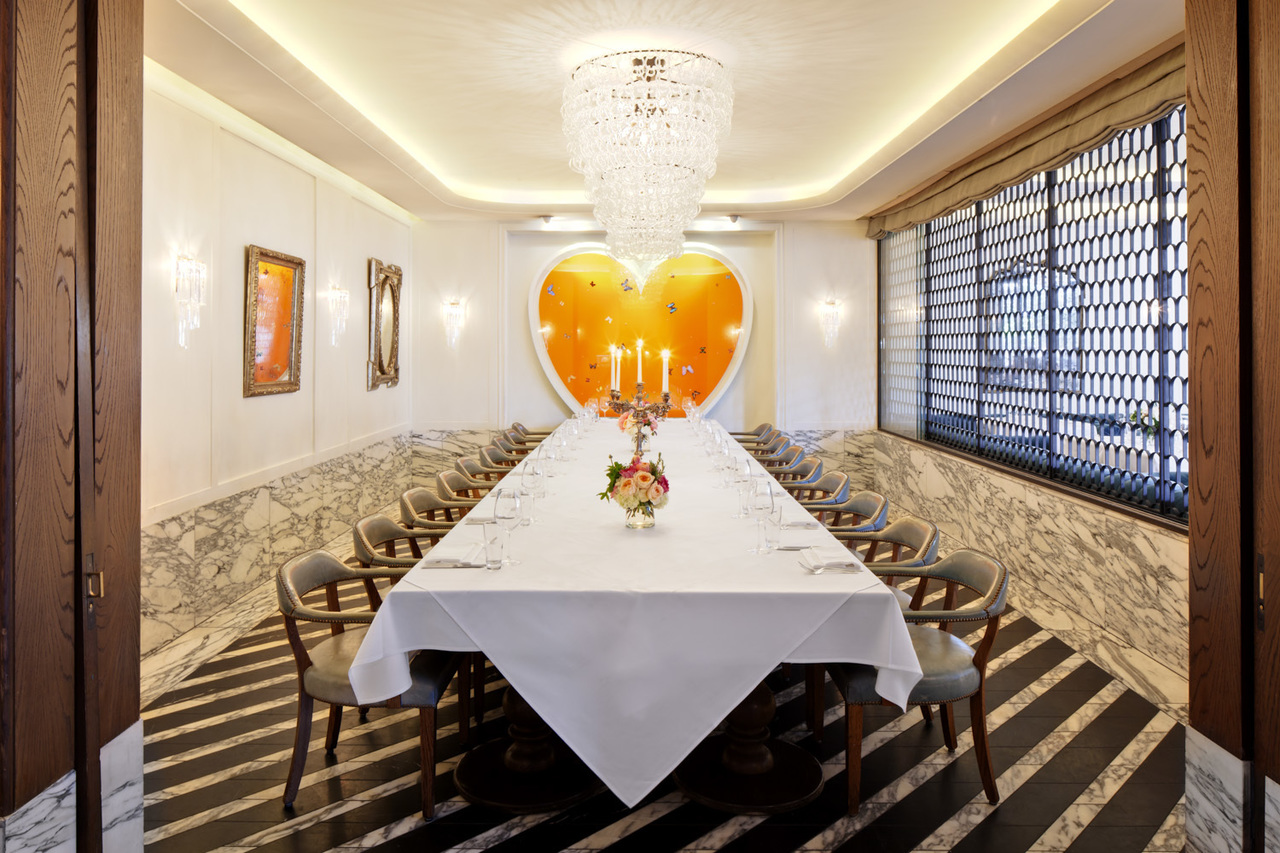 Long dining table with a giant painting of a heart