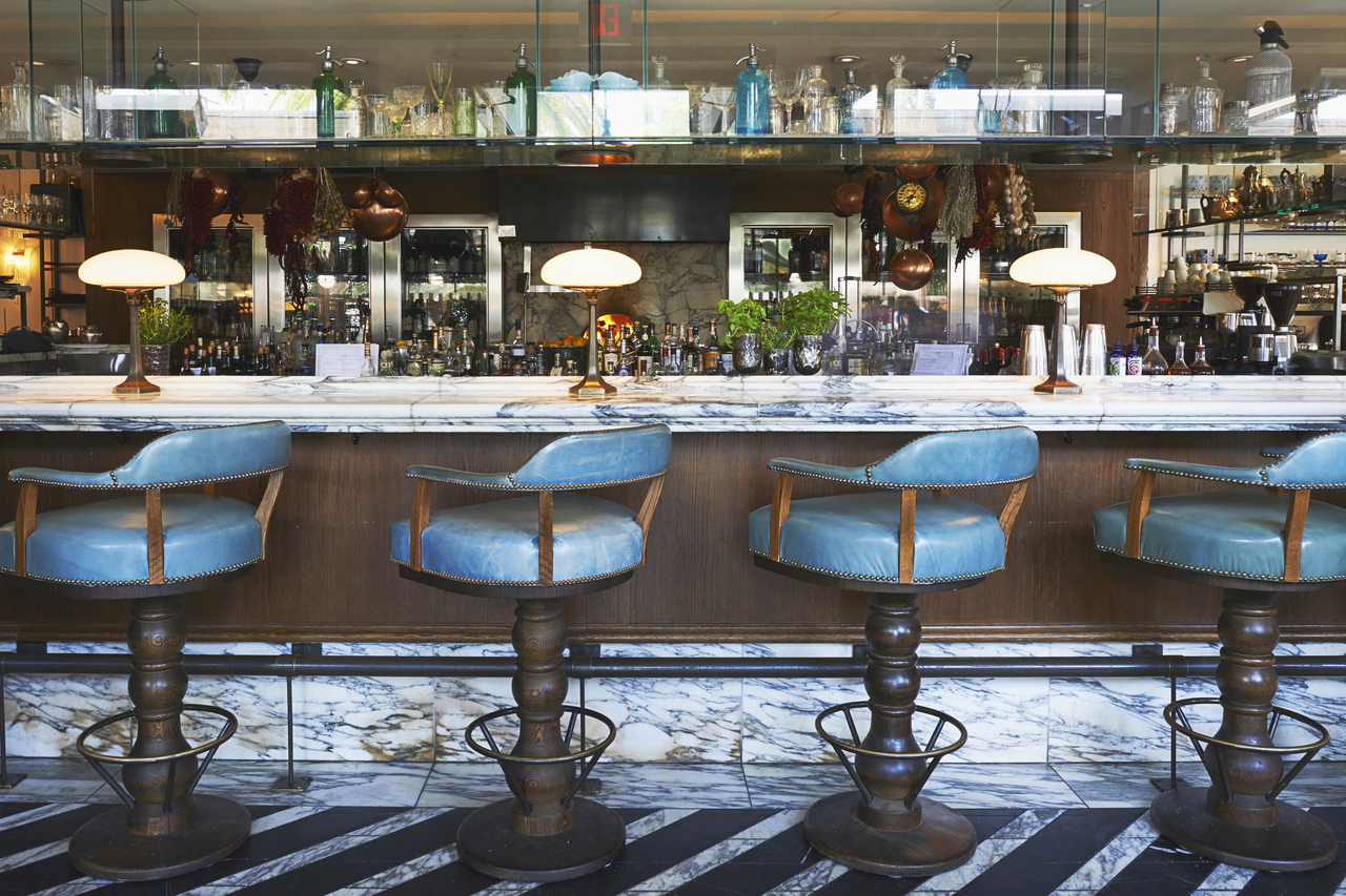 A marble-topped bar with blue stools